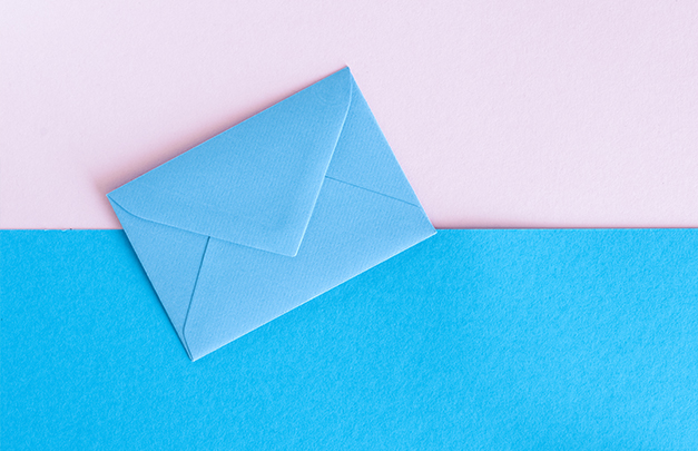 Blue envelope on blue and pink paper