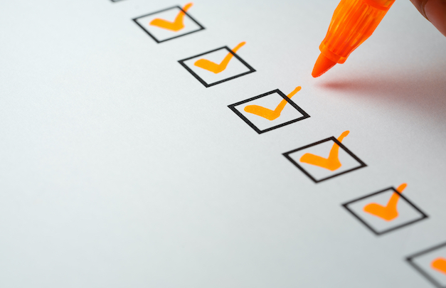 Orange checkmarks on checklist