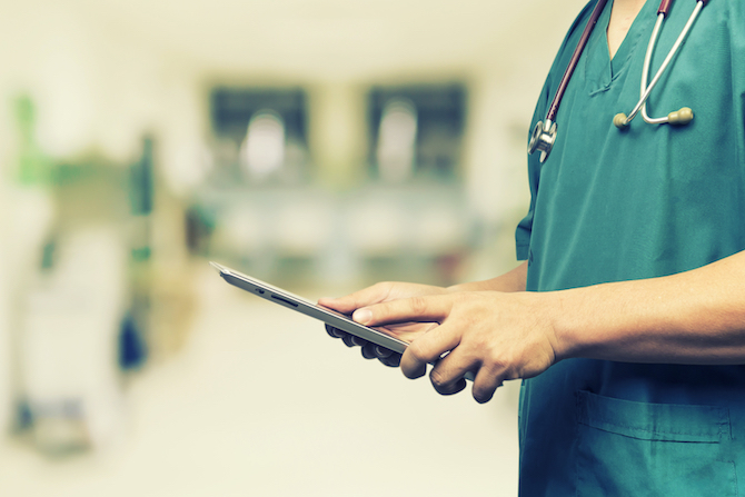 doctor with stethoscope and ipad